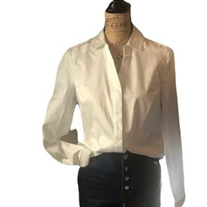 The limited white half button down long sleeve top